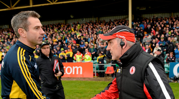 Rory Gallagher and Mickey Harte shake hands after last year's Ulster Championship preliminary round meeting: 'Tyrone were never short of rivals to choose from but Donegal pushed themselves right to the top of the queue.' Photo: Oliver McVeigh