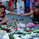 SADNESS: The scene of Thursday's attrocity in Nice, now adorned with floral tributes. REUTERS/Pascal Rossignol