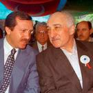 ALL CHANGE: Former allies Recep Erdogan and Fethullah Gulen are now implacable enemies