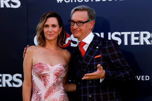 Director Paul Feig poses with cast member Kristen Wiig at the Ghostbusters premiere.