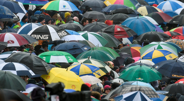 Supporters enduring the rain during an underwhelming contest between Roscommon and Galway last Sunday. Photo by Ramsey Cardy/Sportsfile