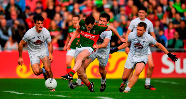 16 July 2016; Diarmuid O'Connor of Mayo shoots to score his side's second goal despite the tackle of Emmet Bolton of Kildare during the GAA Football All-Ireland Senior Championship Round 3B match between Mayo and Kildare at Elverys MacHale Park in Castlebar, Mayo. Photo by Stephen McCarthy/Sportsfile