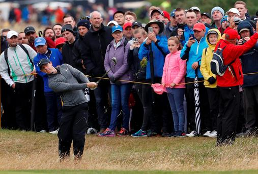 Rory McIlroy plays from the rough on the second hole during the final round