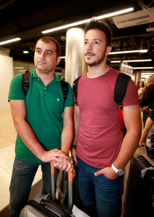 Murat Karavult and Gokhan Bilgi, both from Istanbul pictured after they flew into Dublin Airport from Istanbul. Picture Credit: Frank Mc Grath