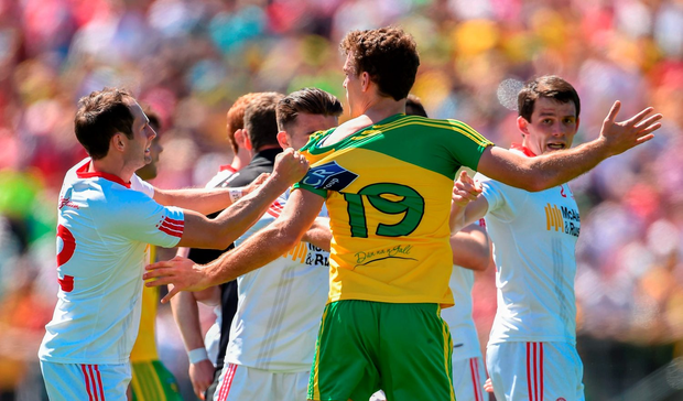 Eamonn McGee of Donegal and Ronan McNabb of Tyrone tussle