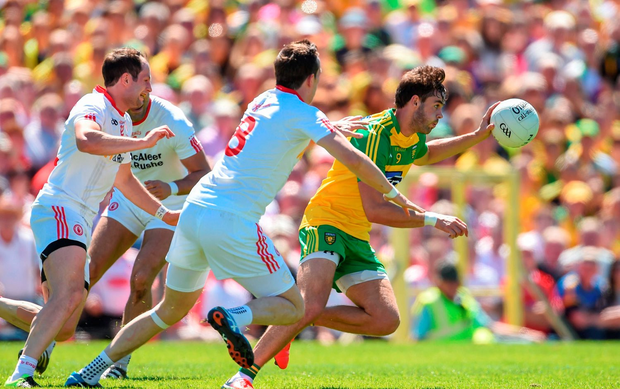 Odhrán Mac Niallais of Donegal in action against Colm Cavanagh of Tyrone