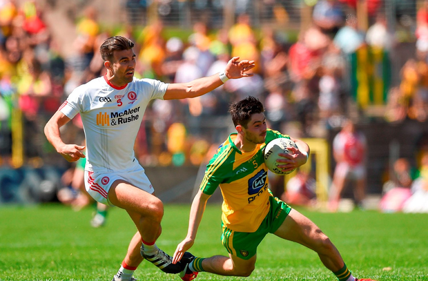 Ryan McHugh of Donegal in action against Tiernan McCann of Tyrone