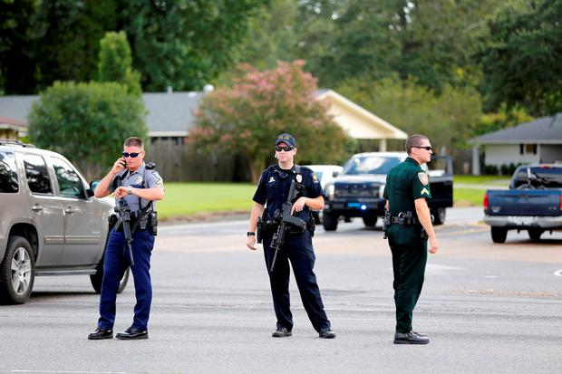 Police officers block off a road after a shooting of police in Baton Rouge, Louisiana