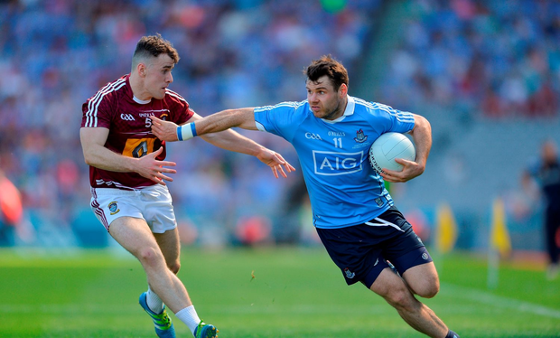 Kevin McManamon of Dublin in action against Jamie Gonoud of Westmeath