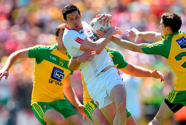 Sean Cavanagh attempts to break through the massed ranks of the Donegal defence. Photo by Ramsey Cardy/Sportsfile