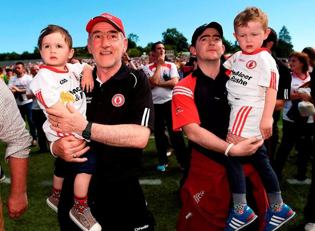 Tyrone manager Mickey Harte with grand son Michael and his son Mark Harte along with his other grandson Liam in Clones. Photo by Oliver McVeigh/Sportsfile