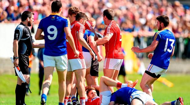 Players from both side's tussle which resulted in a red card for James Loughrey, 6, of Cork and Darren Gallagher, 9, of Longford during their Qualifier clash in Pearse Park on Saturday. Photo by Ramsey Cardy/Sportsfile