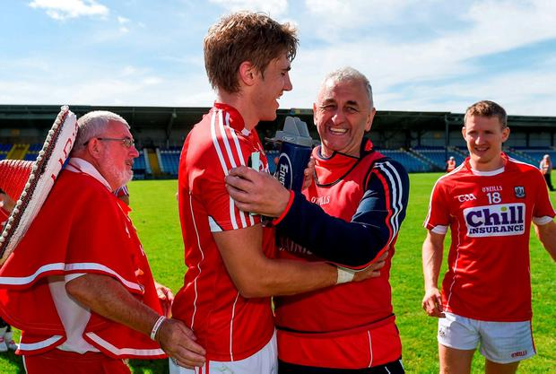 Cork manager Peadar Healy congratulates Ian Maguire after the game. Photo by Ramsey Cardy/Sportsfile