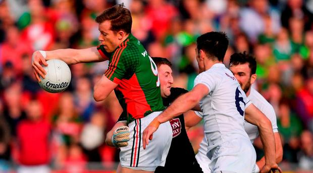 Kildare goalkeeper Mark Donnellan gets to grips with Mayo's Donal Vaughan during their Round 3B qualifier in Castlebar. Photo by Stephen McCarthy/Sportsfile
