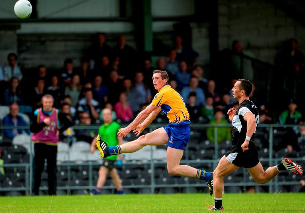 Cathal O'Connor of Clare scoring a point in the second half. Photo by Oliver McVeigh/Sportsfile