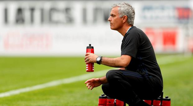 Jose Mourinho takes a water break during the match against Wigan. Photo: Lee Smith/Action Images via Reuters