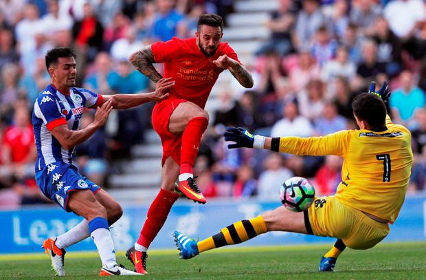 Danny Ings scores Liverpool's first goal against Wigan. Photo: Lee Smith/Action Images via Reuters