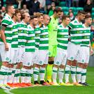 Celtic's players pay tribute to those murdered in the Nice attack during a minute's silence before Saturday's match against Wolfsburg at Parkhead. Photo: Jeff Holmes/PA Wire