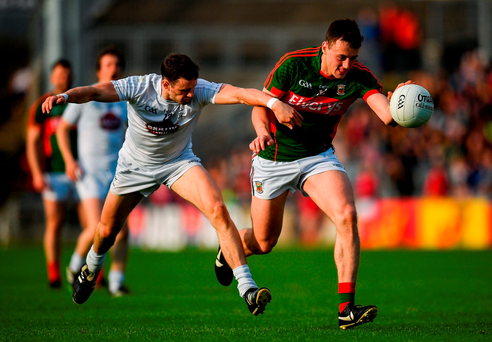 Diarmuid O'Connor of Mayo (right) in action against Cathal McNally of Kildare