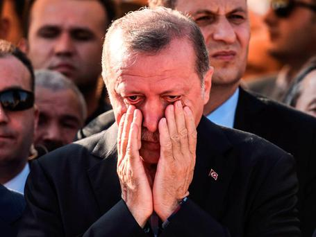 Turkey's President Recep Tayyip Erdogan reacts after attending the funeral of a victim of the coup attempt in Istanbul. Photo: Getty