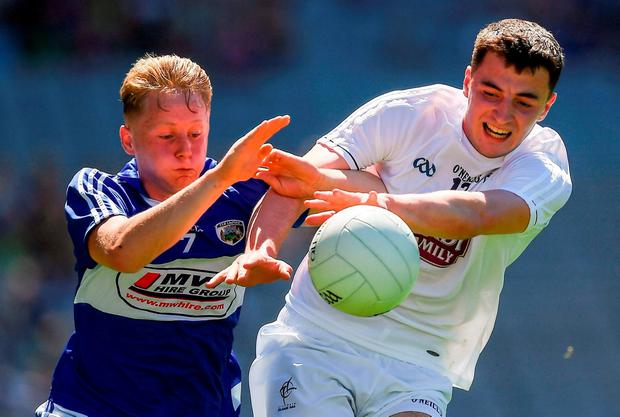 Laois' James O'Connor in action against Kevin Foley of Kildare. Photo by Ray McManus/Sportsfile