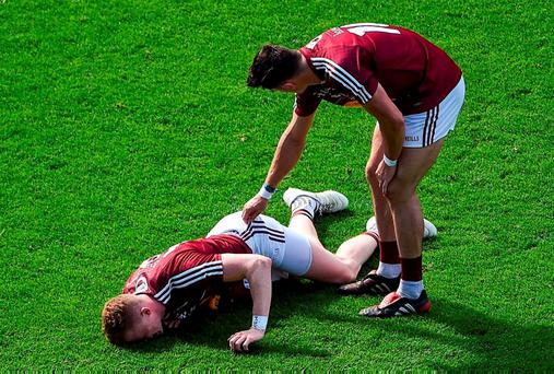 Westmeath's David Lynch consoles team-mate Ray Connellan after Connellan got injured during their defeat to Dublin yesterday. Photo by Daire Brennan/Sportsfile