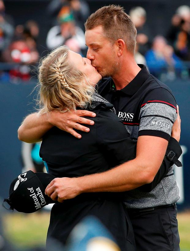 Henrik Stenson being congratulated by his wife, Emma. Photo: Craig Brough/Reuters