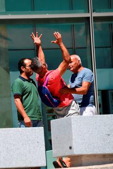 Tahar Mejri, who lost his wife, yells in front of the Pasteur hospital. Photo: Getty