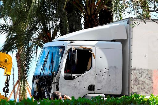 The man described how he saw the 19-tonne lorry begin to plough through crowds of spectators on the promenade and so grabbed a knife and began to run towards the lorry. Photo: Boris Horvat/AFP/Getty Images