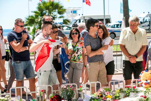 People lay floral tributes and messages to the victims of the attack in Nice. Photo: Kyran O'Brien