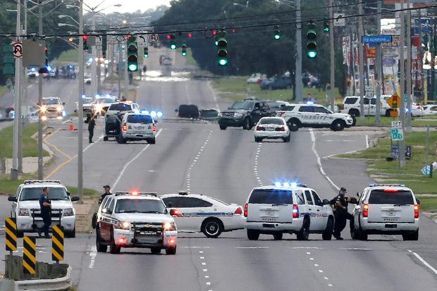 Law enforcement vehicles block access to Airline Highway near the scene of a fatal shooting of police officers in Baton Rouge. REUTERS/Jonathan Bachman