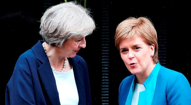 Deal: British PM Theresa May meeting Scottish First Minister Nicola Sturgeon last week. Photo: Andrew Milligan /PA Wire