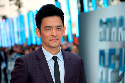Actor John Cho poses for photographers upon arrival at the premiere of the film 'Star Trek Beyond' in London. (Photo by Joel Ryan/Invision/AP)