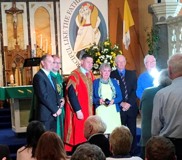 Betty Reilly receiving her father Roys medal
