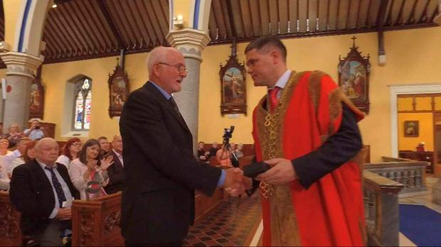 Eric Giggins jnr receiving his fathers medal in Bride Street Church Wexford