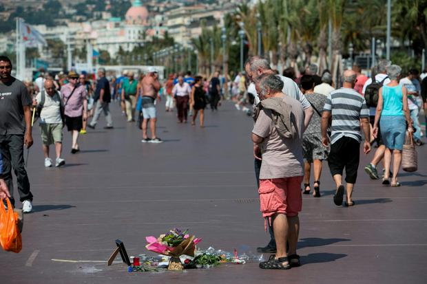 Scene on the Promenade des Anglais in Nice during a Minutes silence in honour of the Victims of the Truck Disaster last Thursday.
