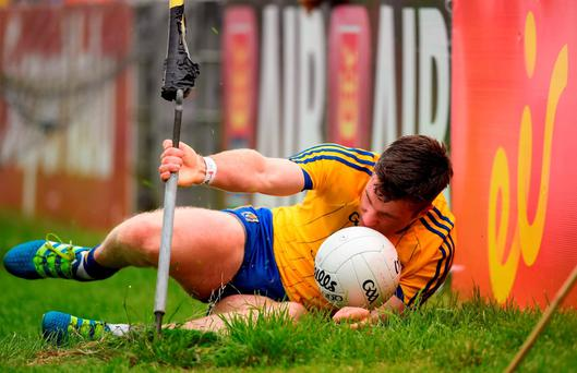 17 July 2016; Cathal Cregg of Roscommon collides with the advertising during the Connacht GAA Football Senior Championship Final Replay match between Galway and Roscommon at Elverys MacHale Park in Castlebar, Co Mayo. Photo by Stephen McCarthy/Sportsfile