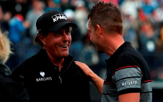 Sweden's Henrik Stenson and USA's Phil Mickelson after The Open Championship 2016 at Royal Troon G