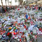 People at a makeshift memorial for the victims of the Nice attack on the Promenade des Anglais Photo: APAP Photo/Luca Bruno