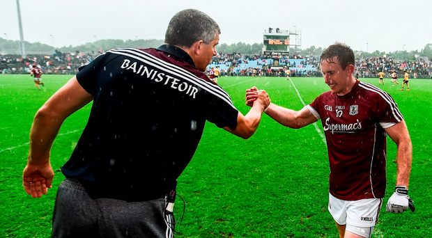Gary Sice is congratulated by Galway manager Kevin Walsh after being substituted in the closing stages of the Connacht SFC final replay Photo: Stephen McCarthy/Sportsfile