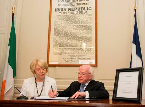 Sabina and Michael D Higgins sign the book of condolence for the victims of the Nice tragedy. Photo: Gareth Chaney Collins