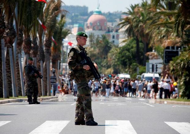Soldiers from the French Foreign Legion patrol on the Promenade des Anglais on the third day of national mourning to pay tribute to victims of the truck attack on Bastille Day. REUTERS/Eric Gaillard