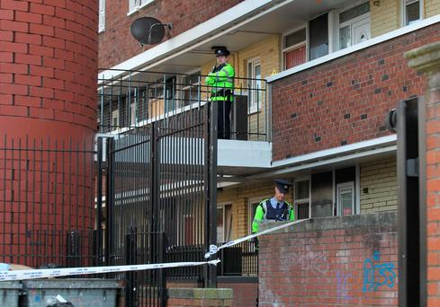 Gardaí preserve the scene at Seagull House on Rutland Avenue in Crumlin, Dublin, where Paul Curran was stabbed. Pic Collins Photos