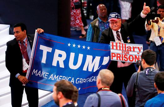 Convention-goers show a Trump banner at the Republican National Convention in Cleveland, Ohio, last night. Photo: Reuters