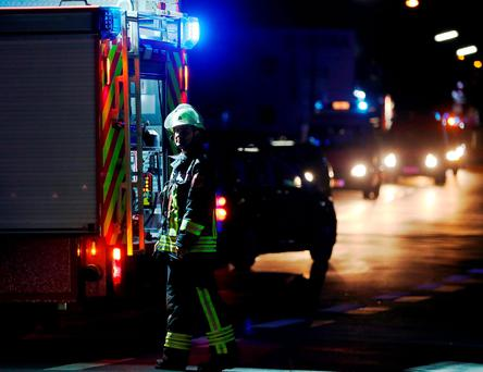 A firefighter stands at a road block in Wuerzburg, southern Germany, Monday evening July 18, 2016. A man attacked people in a train and injured more than a dozen. (Karl-Josef Hildenbrand/dpa via AP)
