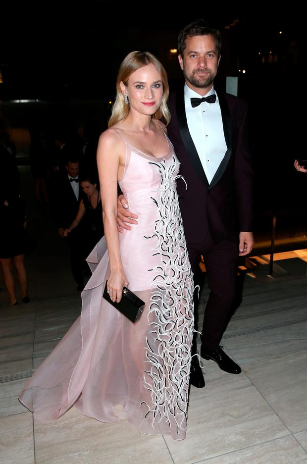 Actors Diane Kruger (L) and Joshua Jackson for FIJI Water At amfAR's Inspiration Gala Los Angeles at Milk Studios on October 29, 2015 in Hollywood, California. (Photo by Joe Scarnici/Getty Images for FIJI Water)