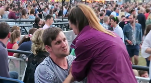 One festival attendee surprised his girlfriend with an impromptu proposal. Photo: YouTube
