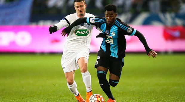 (L-R) Robin Theault of Granville and Georges-Kevin Nkoudou of Marseille during the French Cup game between US Granville V Olympique de Marseille at Stade Michel D'Ornano on March 3, 2016 in Caen, France. (Photo by Vincent Michel/Icon Sport via Getty Images)