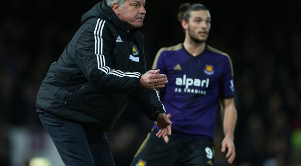 Sam Allardyce Manager of West Ham United and Andy Carroll of West Ham (Photo by AMA/Corbis via Getty Images)