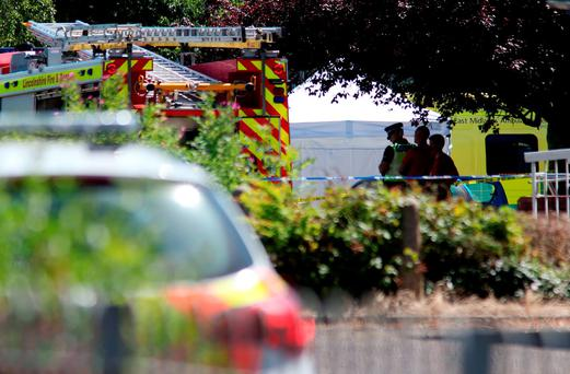 Emergency services at the scene near Castle Swimming Pool in Spalding, Lincolnshire, after three people including a suspected gunman have been shot dead Credit: Chris Radburn/PA Wire